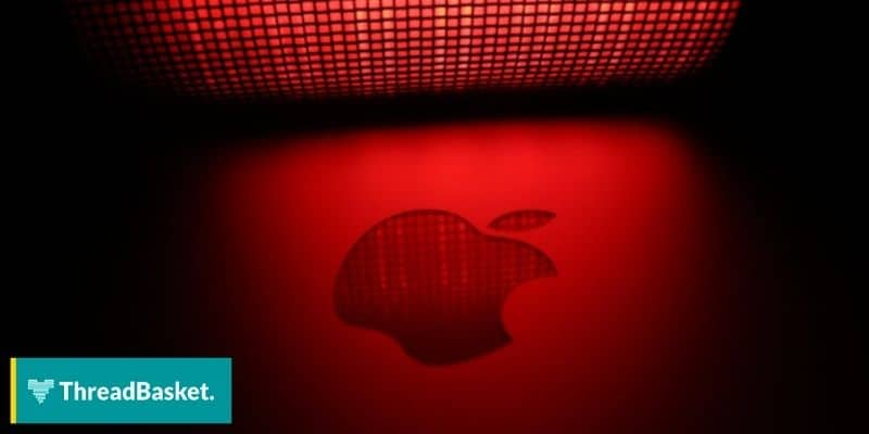 apple logo against red lighting