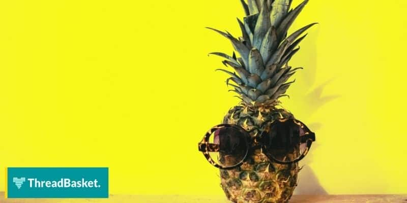 chilling pineapple with shades on the table yellow background