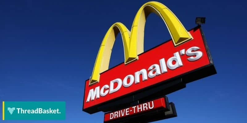 image of mcdonald's storefront logo and drive thru sign