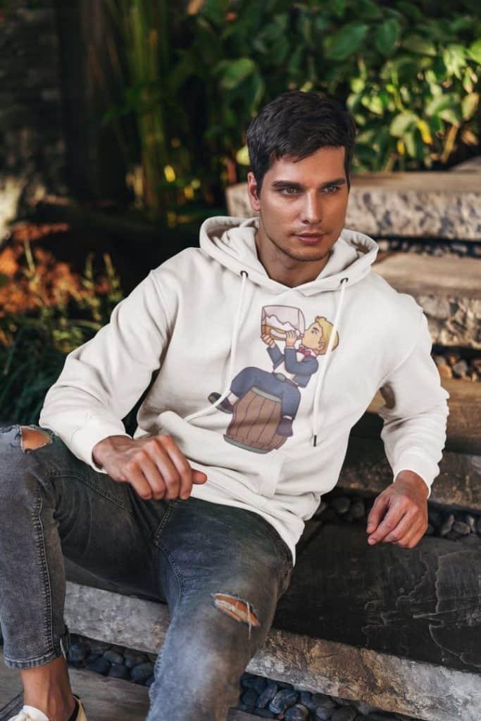 sublimated hoodie mockup of a man posing in a garden 5121 el1