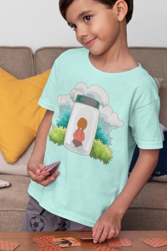t shirt mockup featuring a kid playing a memory card game 32165