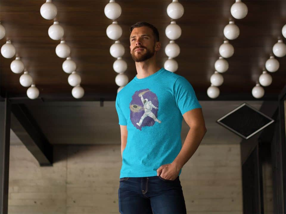 photo of a handsome man in a restaurant wearing a shirt with a space dunk design