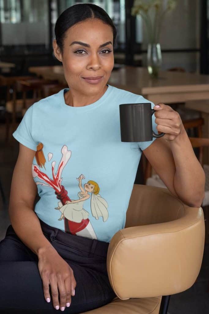 t shirt mockup of a woman sitting on a chair holding an 11 oz coffee mug 31705