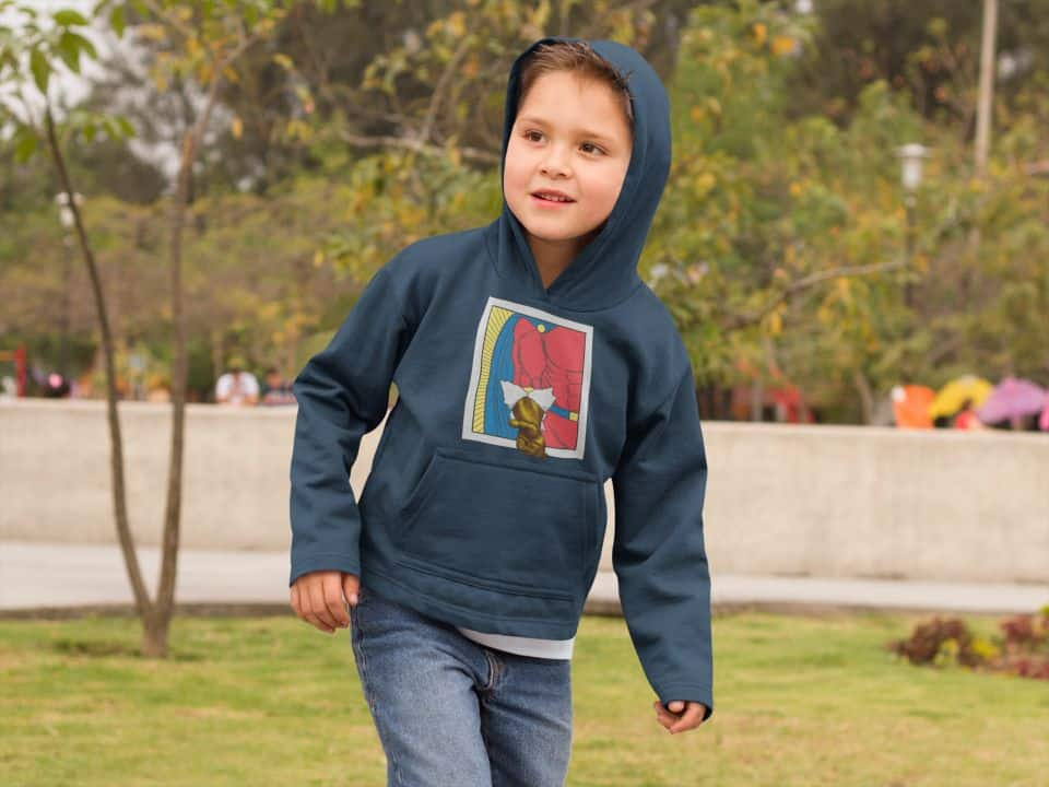 photo of a kid in a park wearing a hoodie with a hero alive design