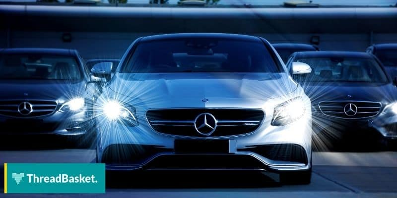 image of mercedes benz cars with headlights on