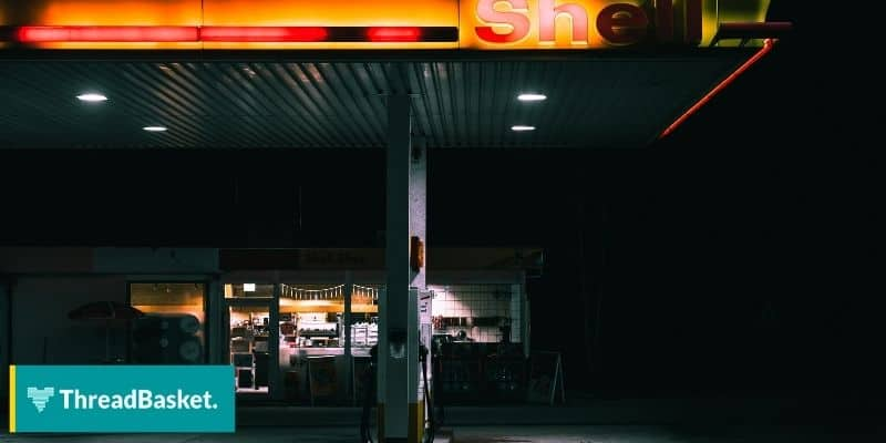 image of a shell gasoline station at night with bright logo