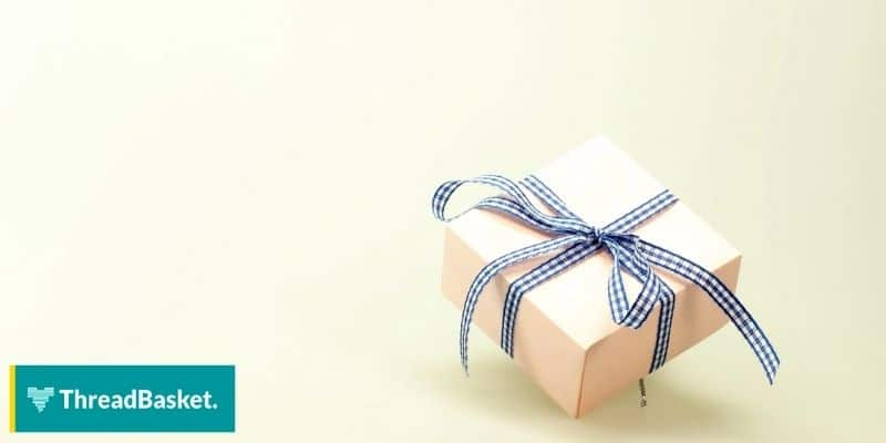a box with a bow tie against a blank backgrund