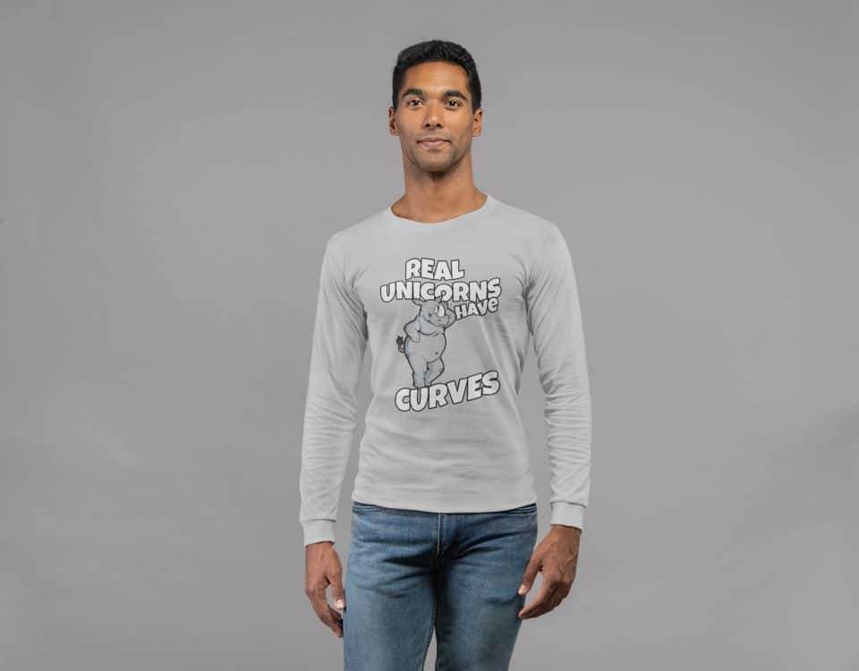 photo of a fit man posing at the camera wearing a long sleeve shirt with a real rhino rifts design
