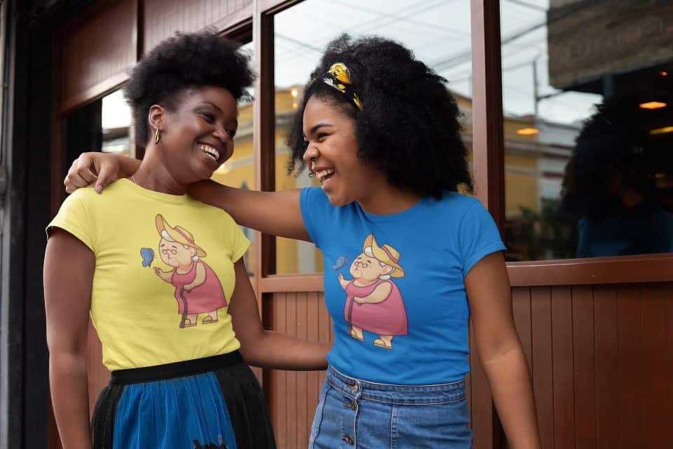 mockup of two friends with t shirts chatting outside a bar 32303