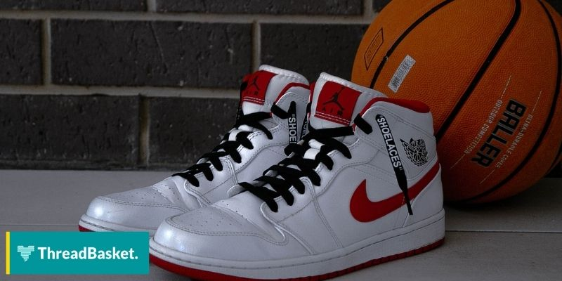 nike air jordans shoes with a basketball on the ground