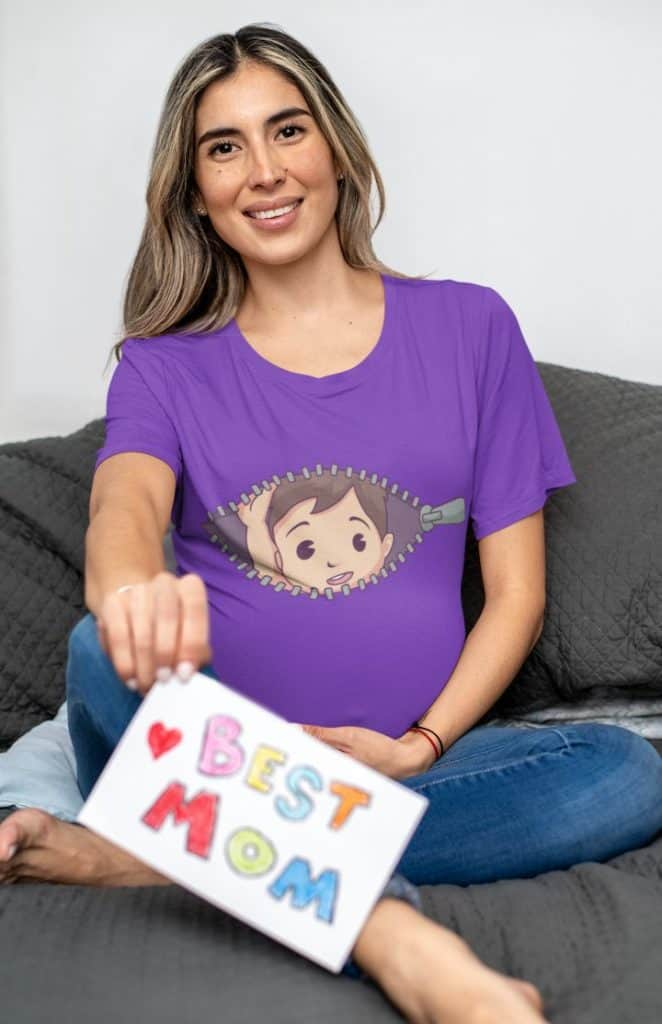 t shirt mockup featuring a pregnant woman sitting on a couch 32247