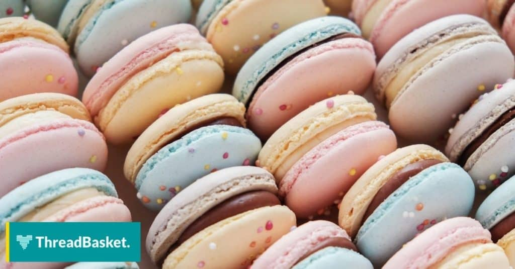 pastel colored macaroons with some rainbow sprinkles