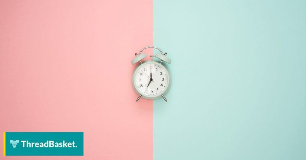 two tone pastel color read and green with clock at the middle