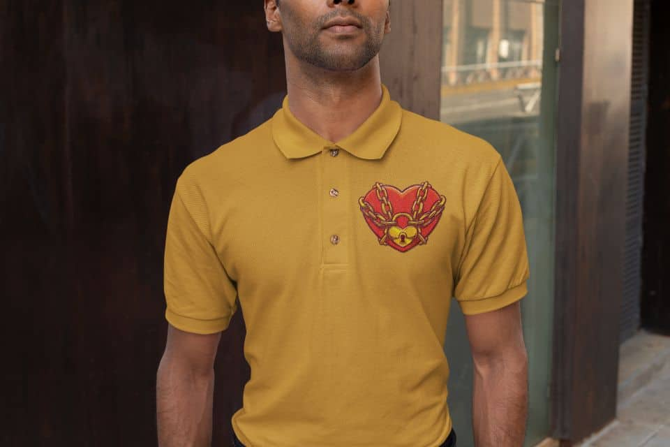 photo of a serious man wearing a yellow polo shirt with a heart lock design