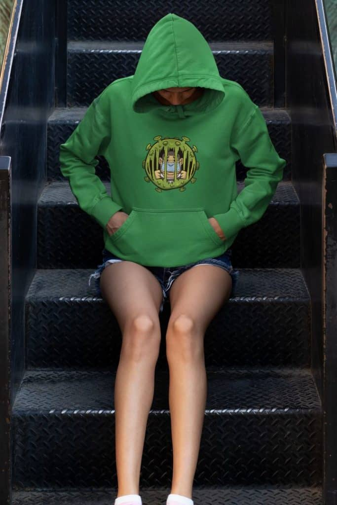 hoodie mockup of a young woman sitting on some steps