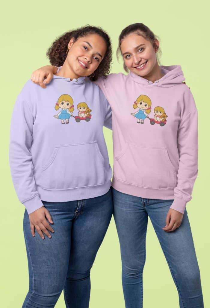 photo of two close friends in a studio wearing a hoodie with sister playtime design