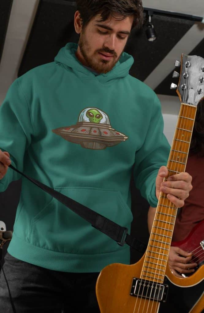 mockup of a guitarist wearing a hoodie with alien design