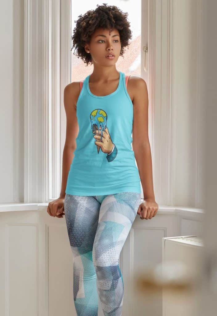 mockup of a woman wearing a sublimated tank top and posing by a window