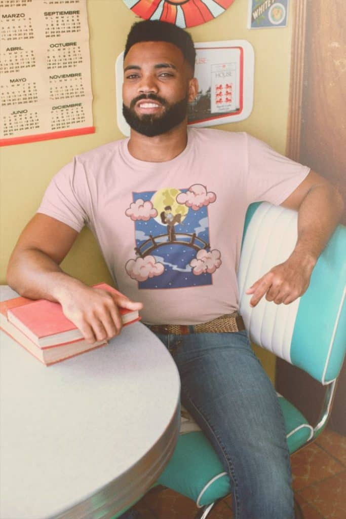 Round neck tee mockup of a smiling man at a retro setting