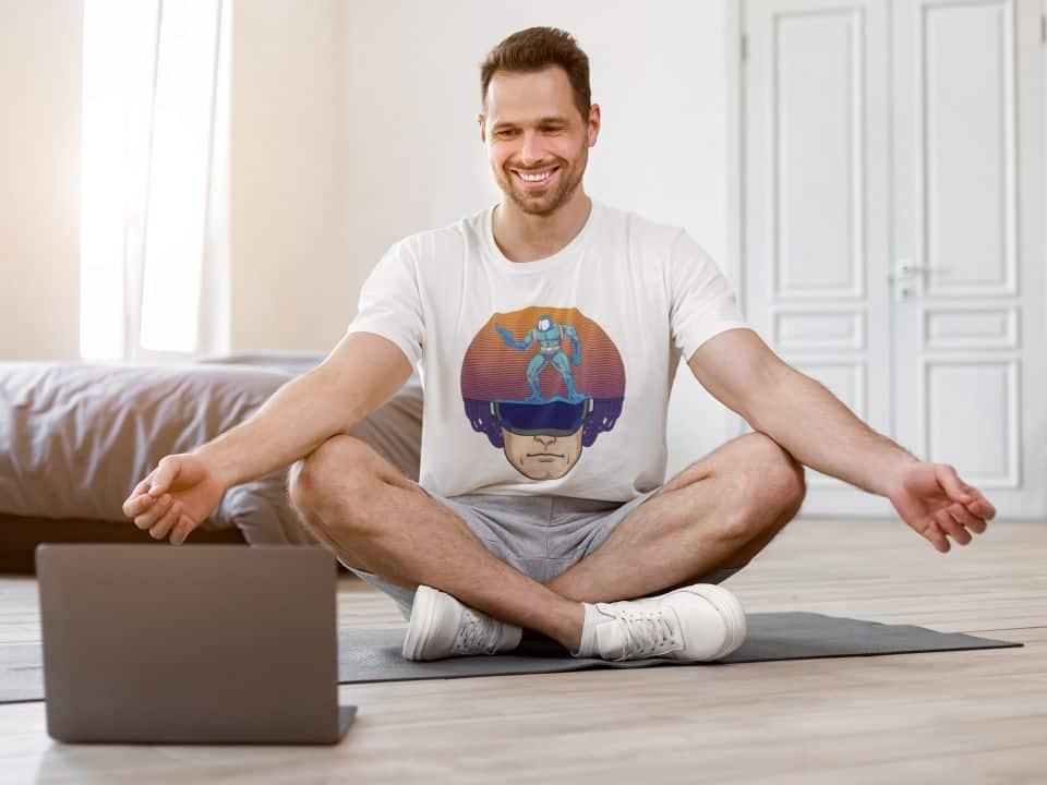 t-shirt mockup of a smiling man taking a virtual yoga class