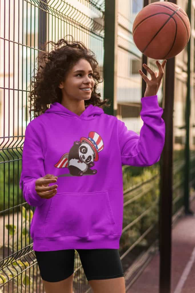 photo of a happy woman playing basketball wearing a hoodie with an american panda design