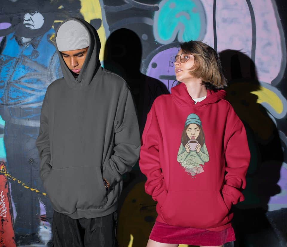 photo of two friends posing for the camera and the girl is wearing a hoodie with a survival juice design