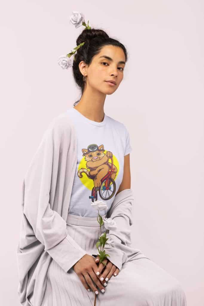 photo of a girl sitting and holding some roses wearing a shirt with Cool BMX Kitty design