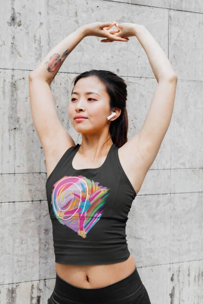 photo of a woman stretching her arms wearing a tank top with a rainbow swirl design