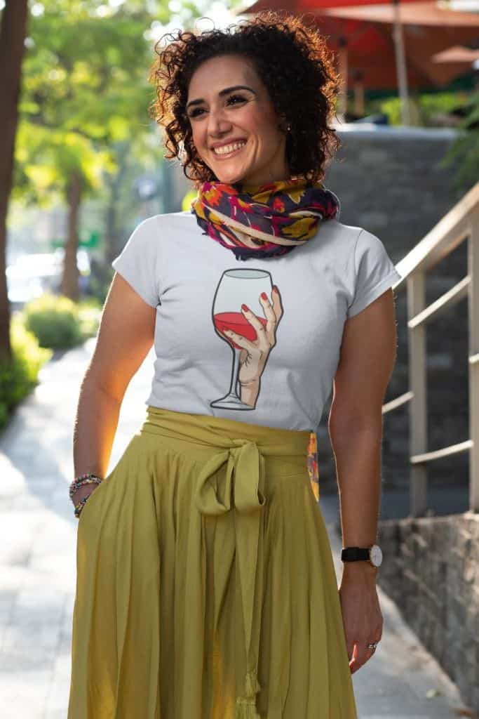 photo of a happy woman walking down the street wearing a shirt with wine not design
