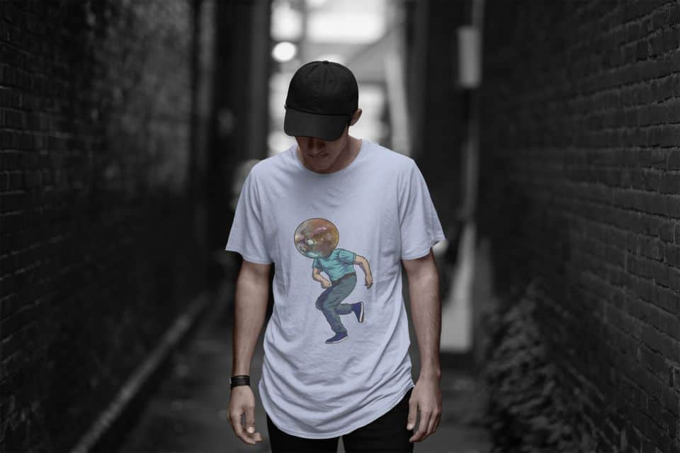photo of a cool man posing in a dark alley wearing a shirt with a disco lover boy design
