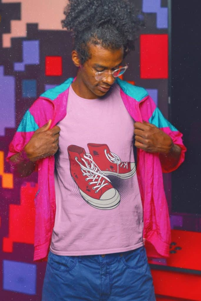 photo of a man wearing 80's clothes and an inside shirt with red kicks design
