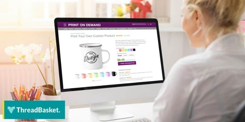 woman in front of a computer making designs for print on demand store