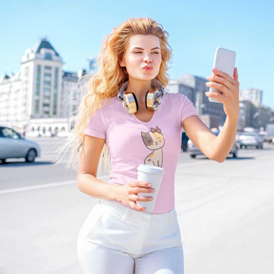 mockup of a blonde woman taking a selfie on the street