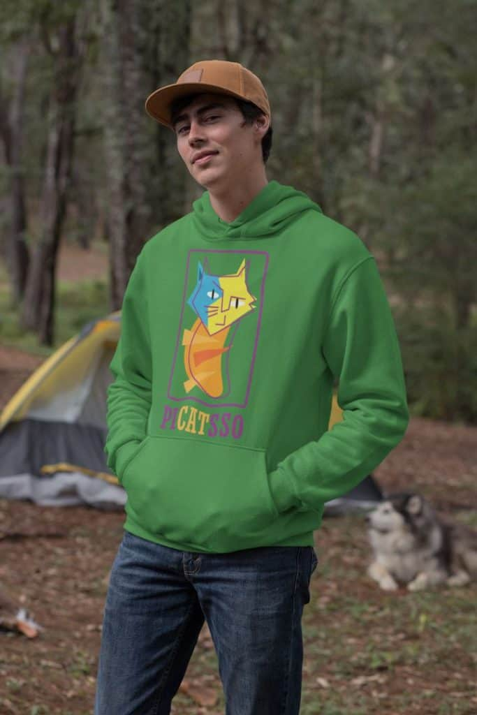 mockup of a man wearing a pullover hoodie in the woods