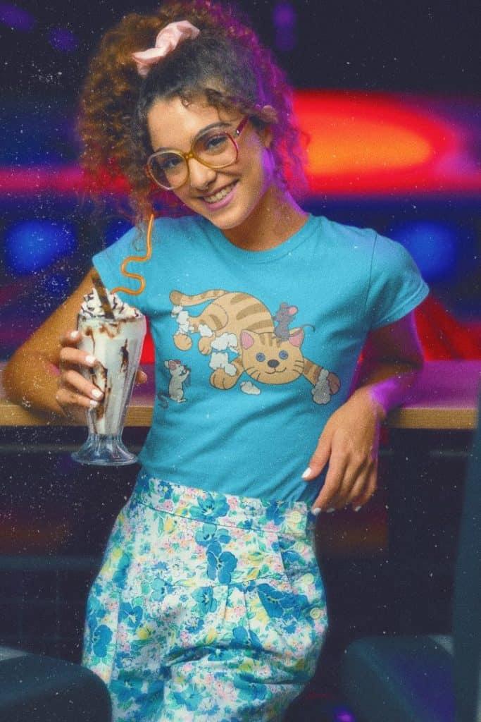 retro t shirt mockup featuring a woman holding a milkshake