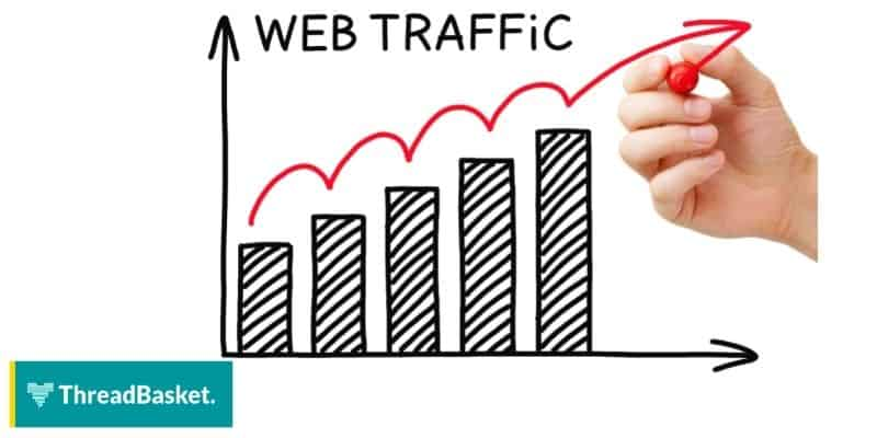 bar graph showing the web traffic trend and a hand writing an arrow upwards