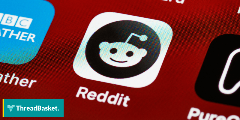 black and white reddit logo on an iphone sceen
